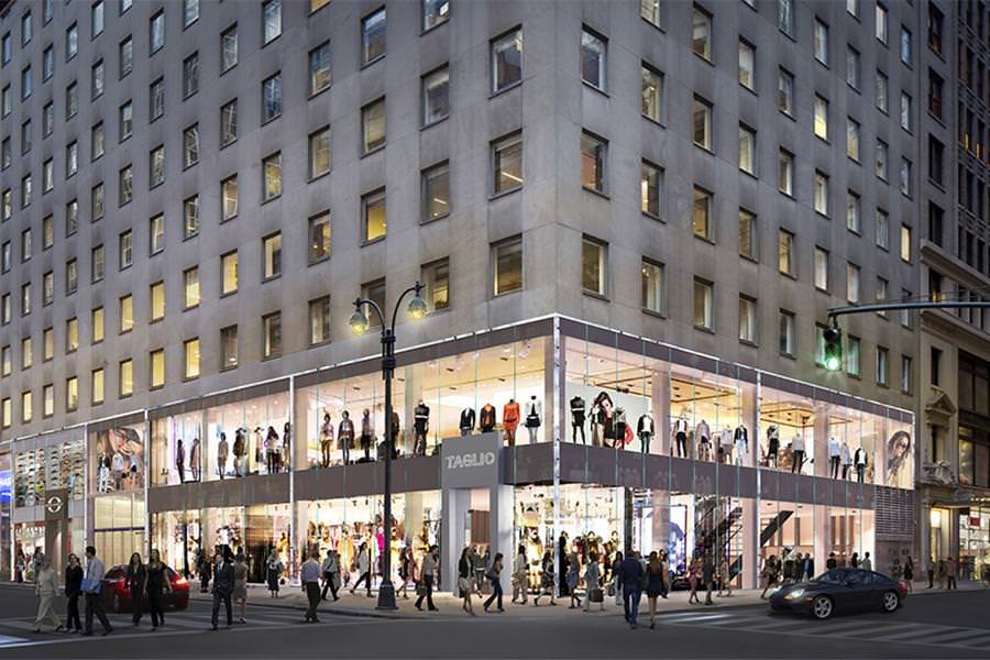 The corner of the 530 Fifth Avenue property is brightly lit up at night attracting shoppers and people walking by.