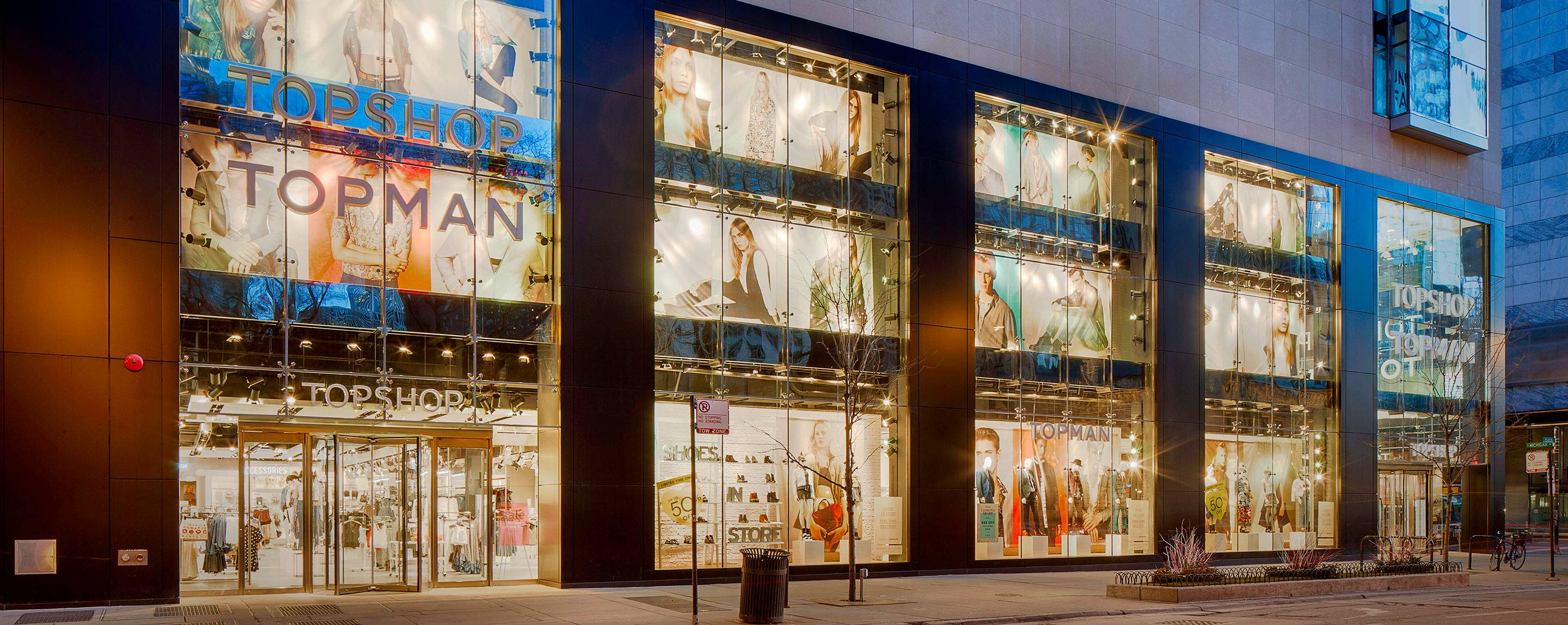 The property on 830 North Michigan Ave highlights the Top Shop retailer with brightly lit storefronts.