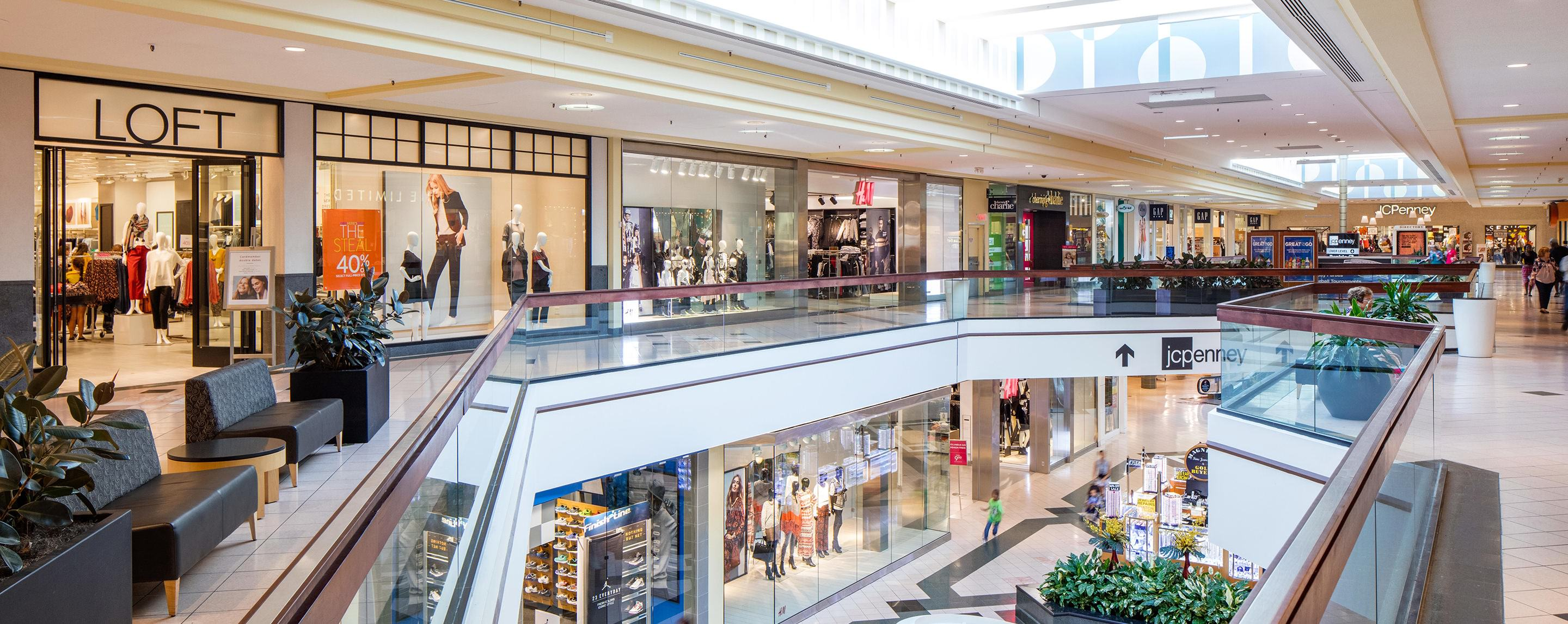 The upstairs walkway in Altamonte Mall gives you an open view of store fronts and seating areas for shoppers.
