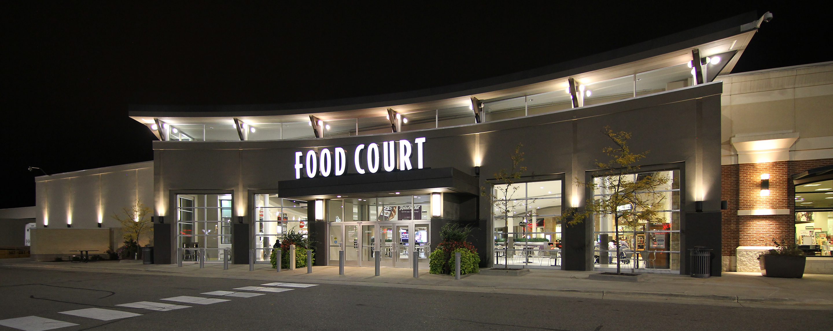 At night, the Apache Mall food court lights up the exterior entrance for visitors and shoppers.