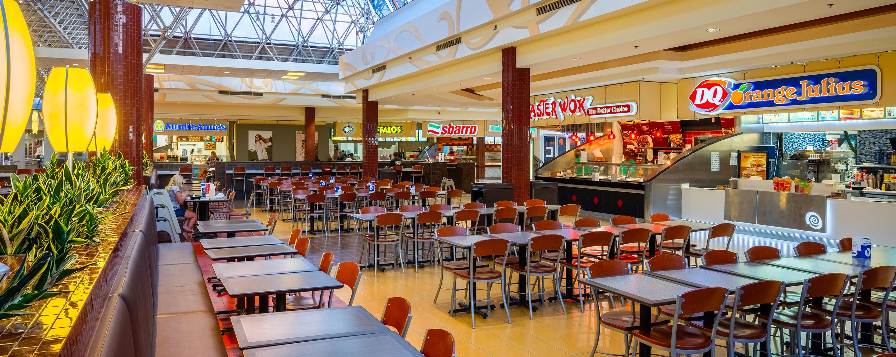 The Augusta Mall's food court offers tables, booths, and chairs for shoppers and visitors to relax and eat.