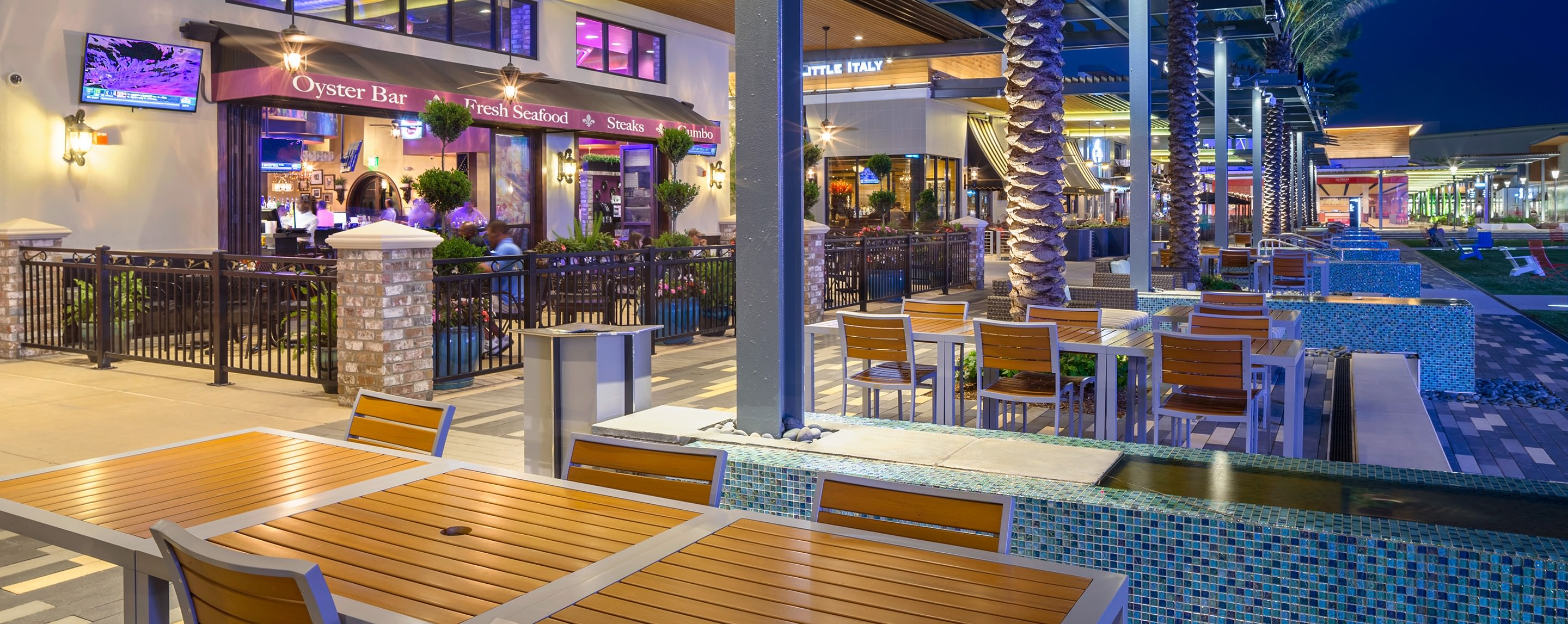 At night, the lit up outside seating area of the Baybrook Mall's full service restaurant seats shoppers to eat and relax.