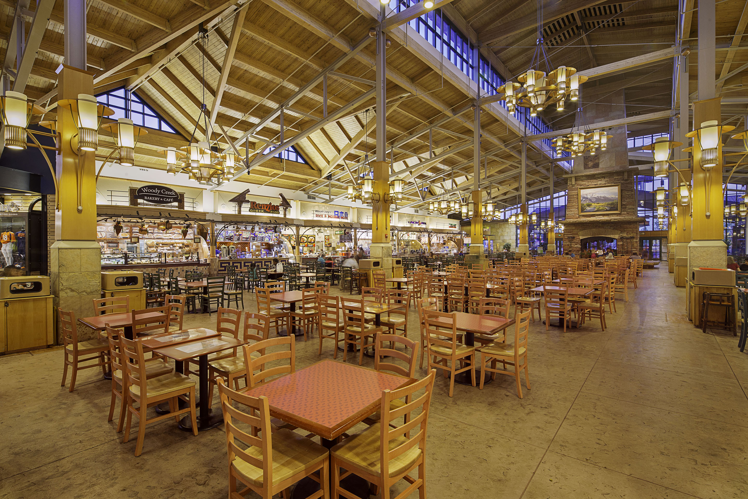 The Park Meadows food court is filled with tables and chairs with a variety of dining options.