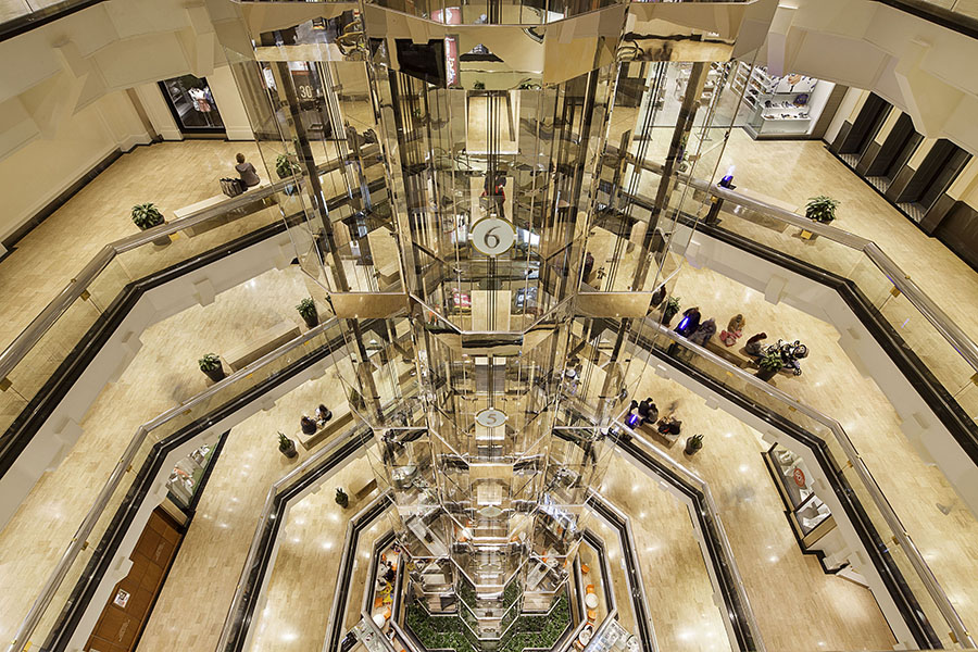 A view from the 7th level in Water Tower Place looking down to the ground level with the glass elevator.