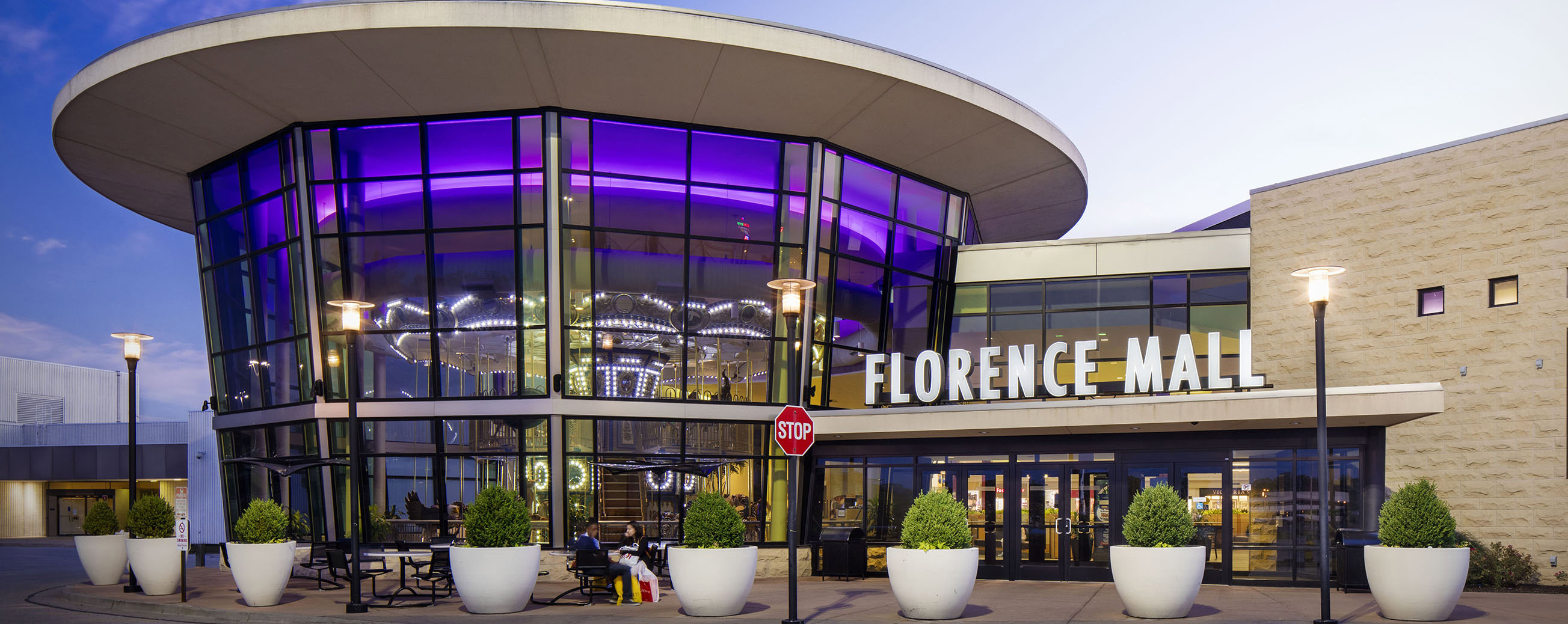 From just outside the Florence Mall, shopper can see the lit up carousal through the large glass windows.