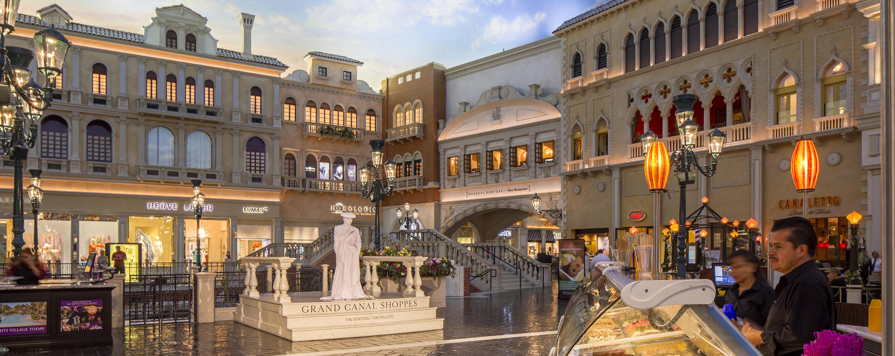 Shoppers stroll through the interior common area of the Grand Canal Shoppes that is designed to look like a replica of a small Venetian village.