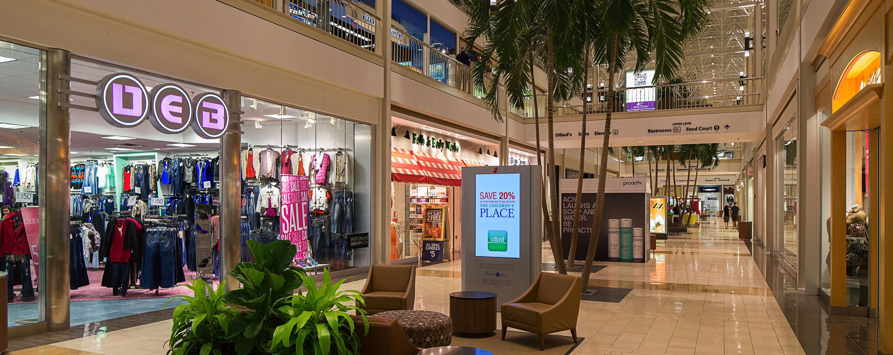 In the Hulen Mall's lower level walkway, shoppers have the option to peer inside store fronts, sit and relax, or search the directory to find something specific.