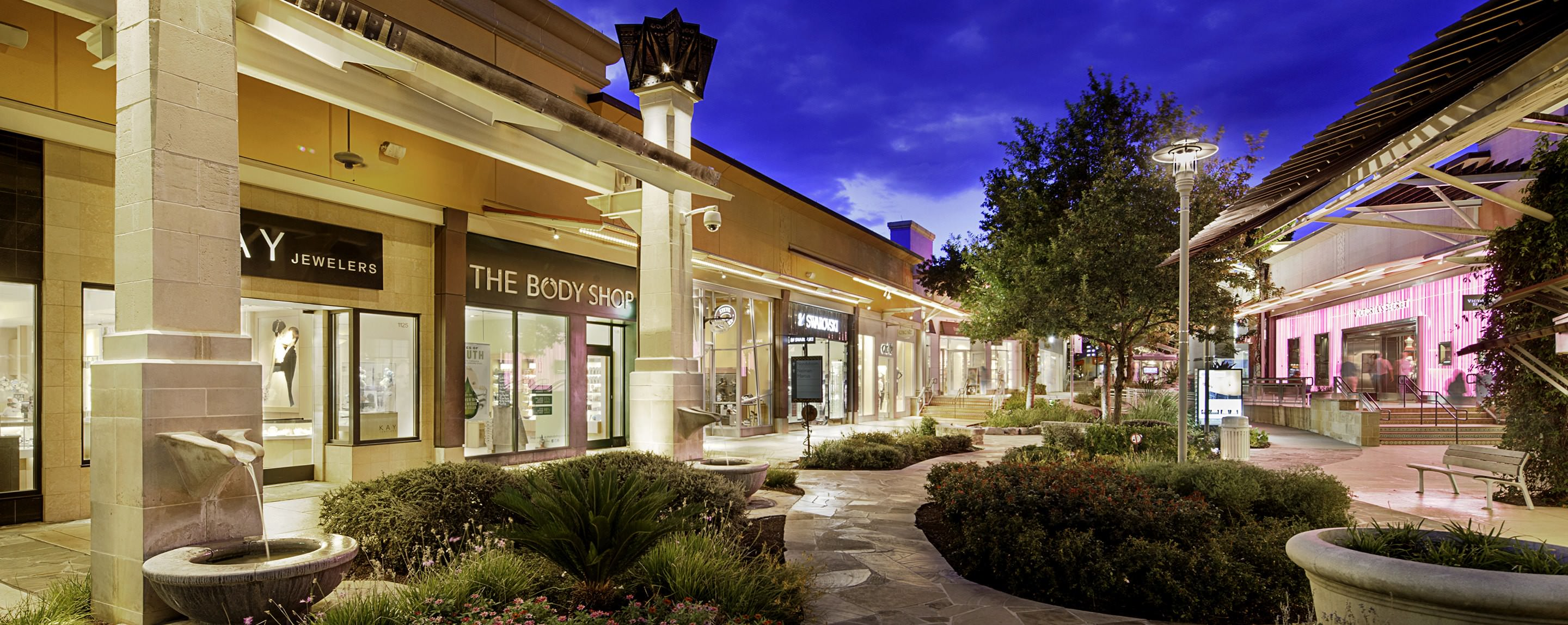 ... Storefronts At The Shops At La Cantera Light Up The Surrounding Area  And Lush Landscaping.