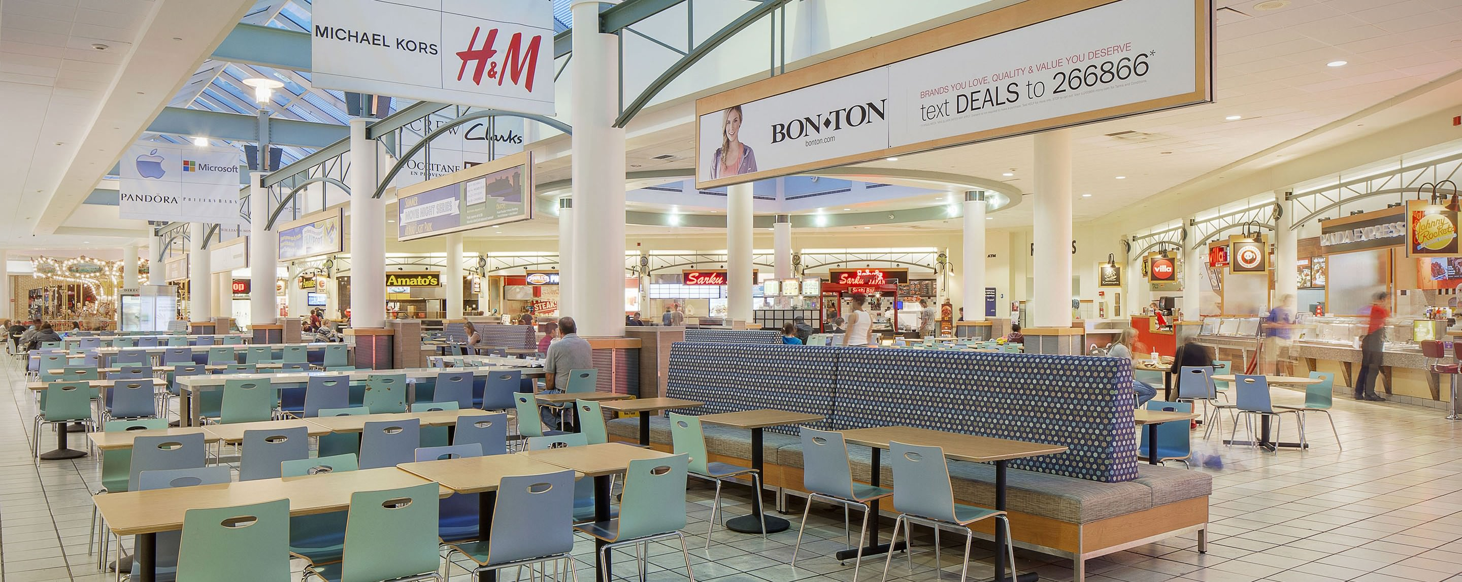 ... Visitors Sit In A Brightly Lit Food Court At The Maine Mall, Surrounded  By A