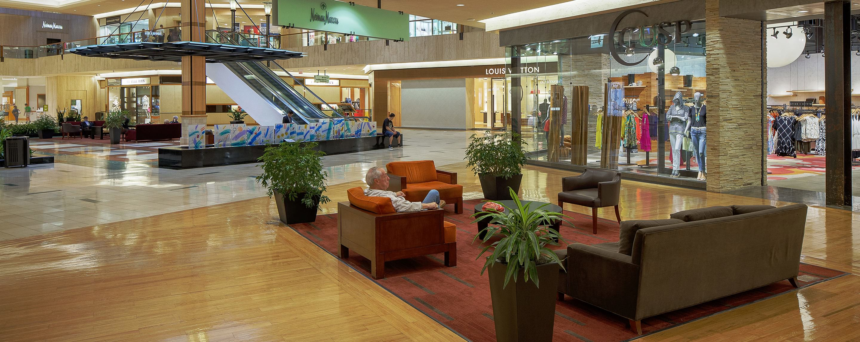 An interior common area at Northbrook Court has seating options for shoppers and views of upper level store fronts.