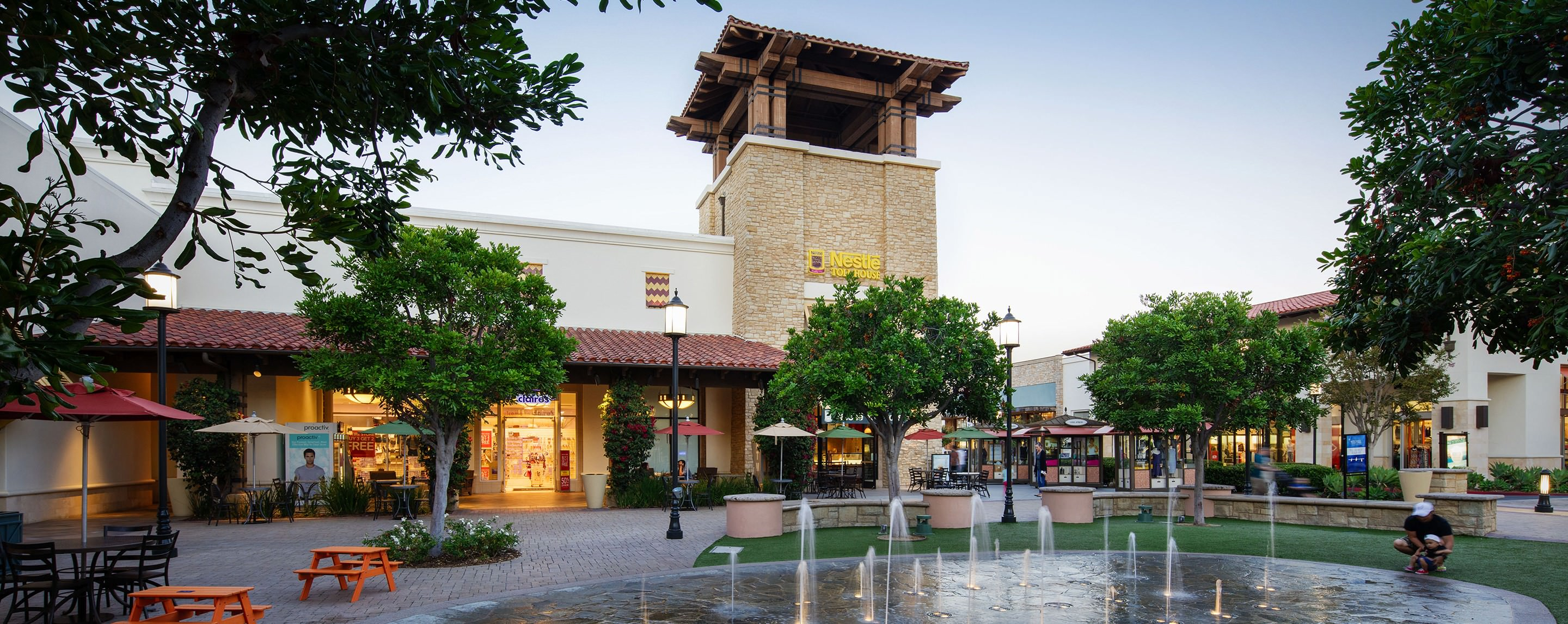 A decorative fountain and seating area fill up an outdoor common area at Otay Ranch Town Center