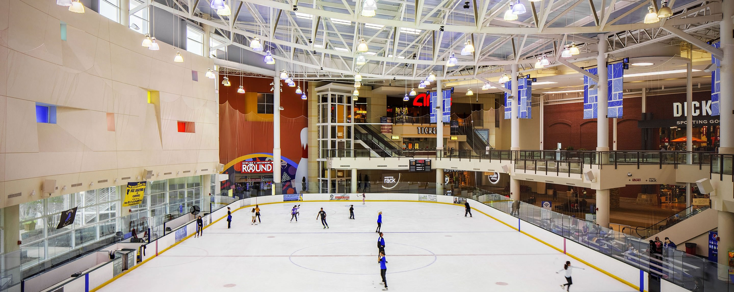 Visitors enjoy the ice skating rink at The Parks Mall at Arlington.