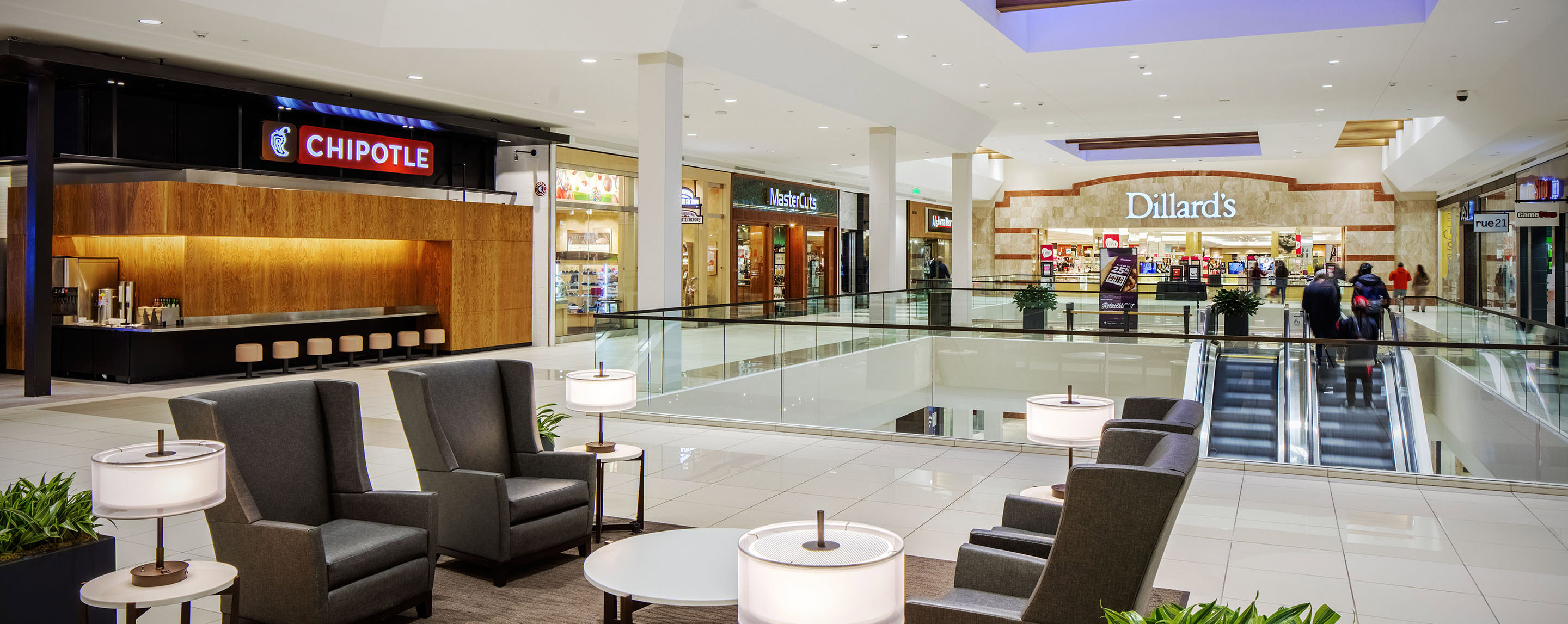 Shoppers come up the elevators to the second level of Southwest Plaza, which offers comfortable seating and a variety of restaurants and retailers.