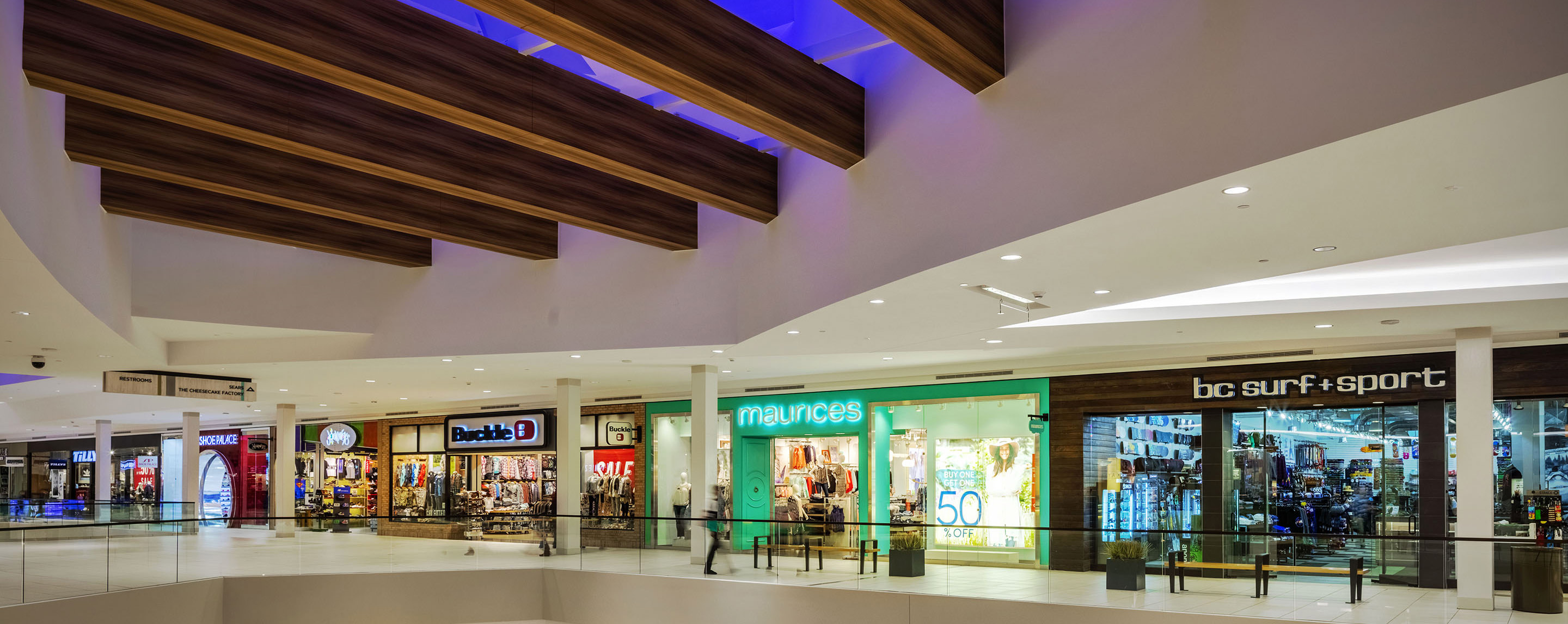 Under a decorative skylight, Buckle, maurices and Bc Surf & Sport are some of the stores on the second level at Southwest Plaza.