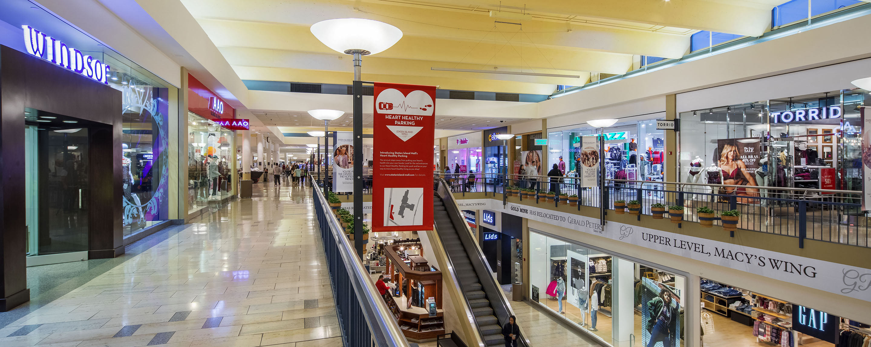 On two levels of the Staten Island Mall, there are a variety of retailers to which shoppers can get to via a centrally located escalator.