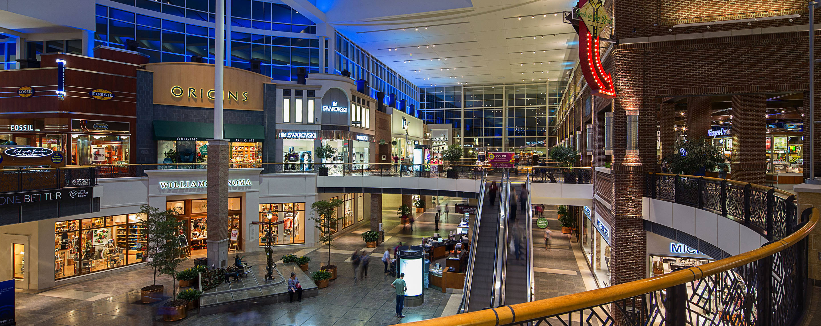 The interior of The Streets at Southpoint is shown from the second floor as shoppers can be seen strolling throughout the mall.