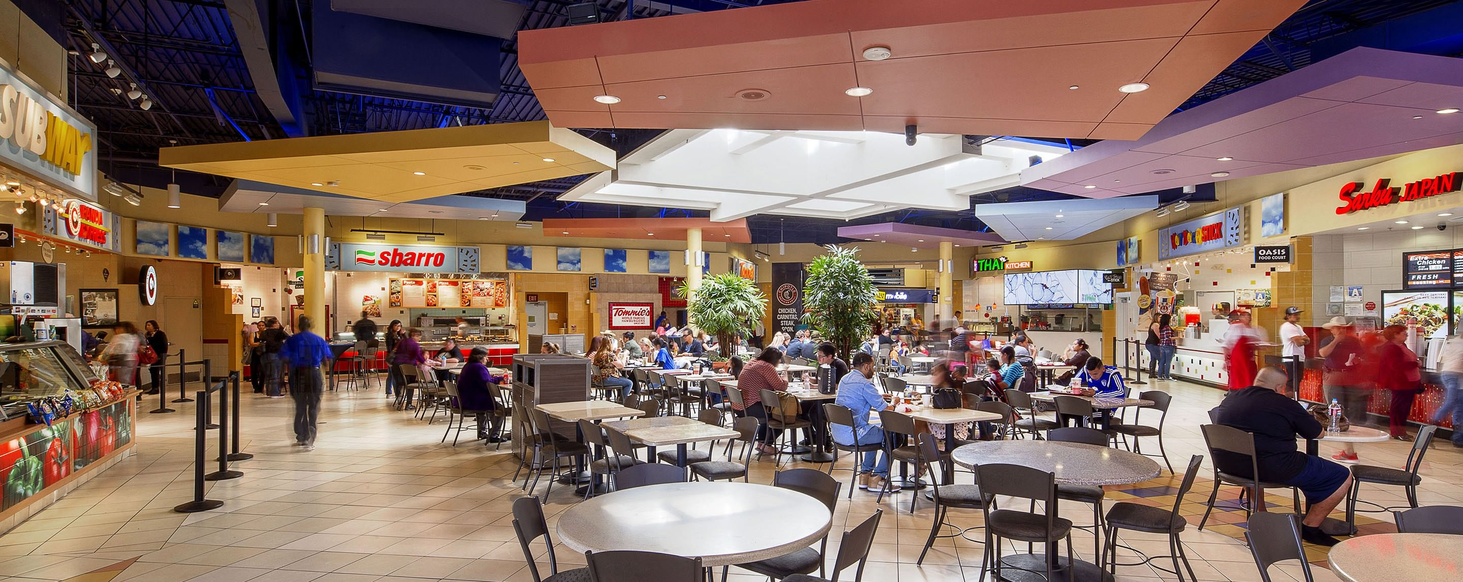 Shoppers sit and eat in the Valley Plaza food court where there is ample seating available for guests.