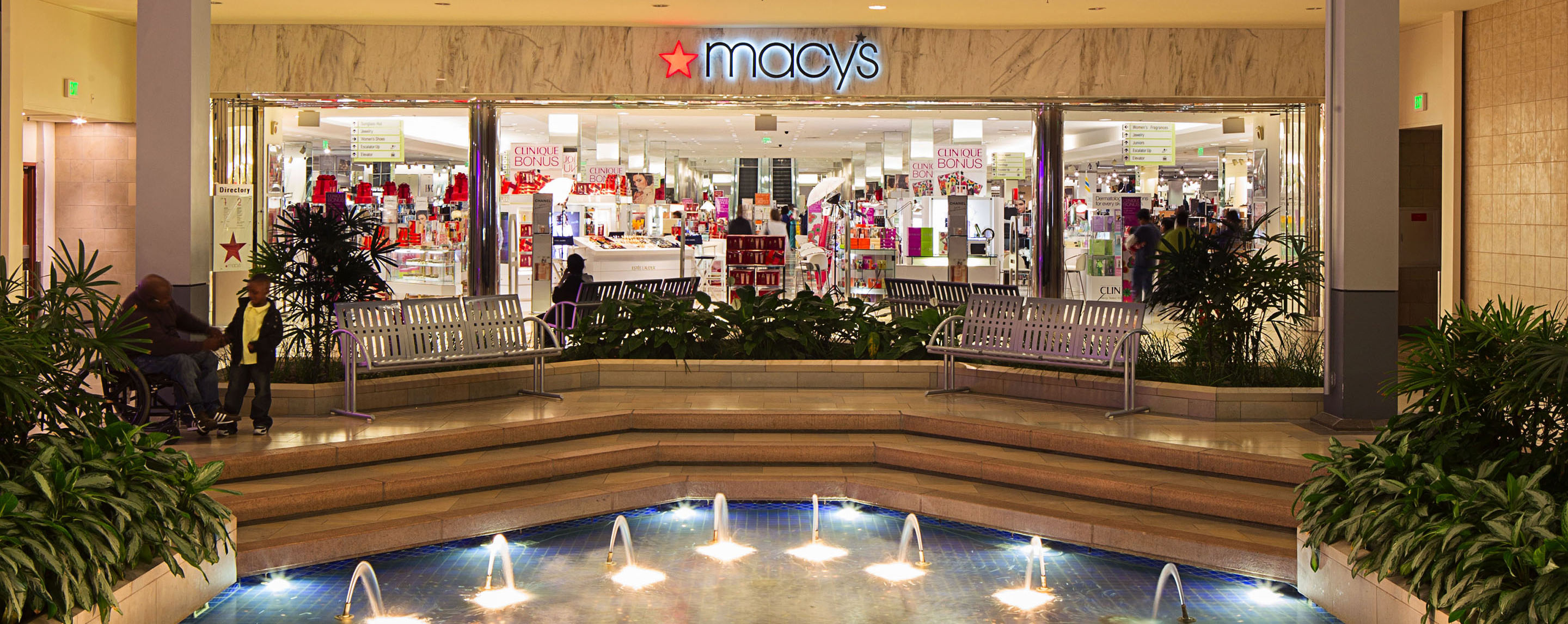 Outside of the White Marsh Macy's shoppers take a break near a decorative fountain.