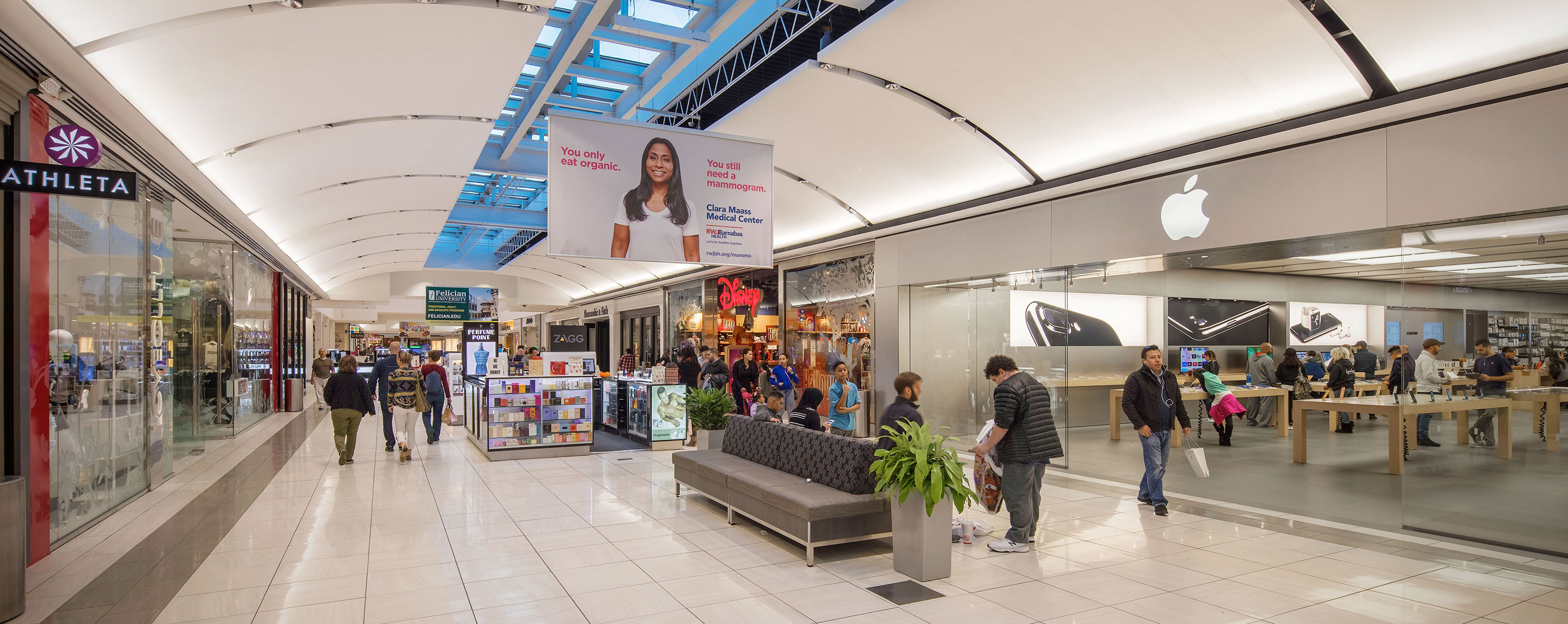 In the lower walkway of Willowbrook, shoppers stroll from store to store and pass by kiosks.
