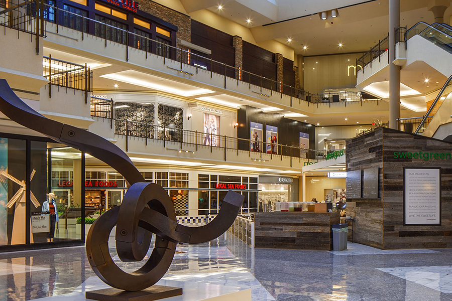 A center court of Tysons Galleria includes a sculpture and various stores.
