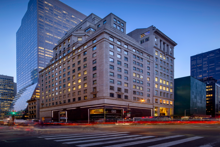 GGP's 685 Fifth Avenue property is lit up at dusk as traffic pass by the building 2