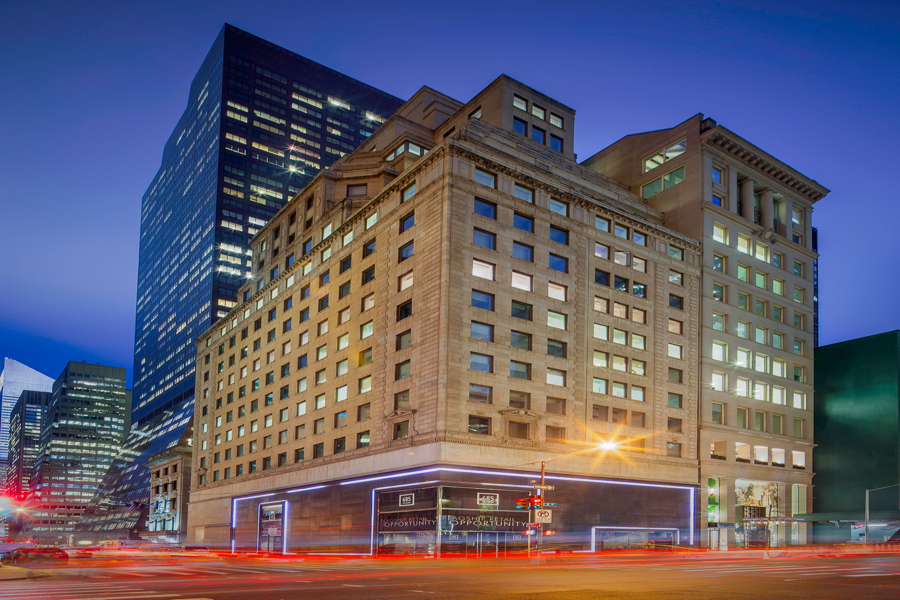 GGP's 685 Fifth Avenue property is lit up at dusk as traffic pass by the building 3